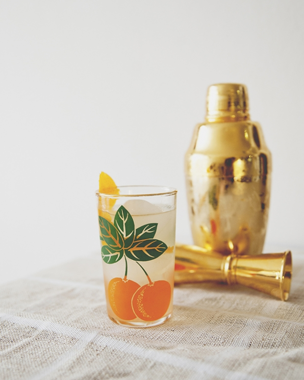 MISH MISH COCKTAIL with orange twist in glass with brass cocktail shaker and double jigger // The Kitchy Kitchen