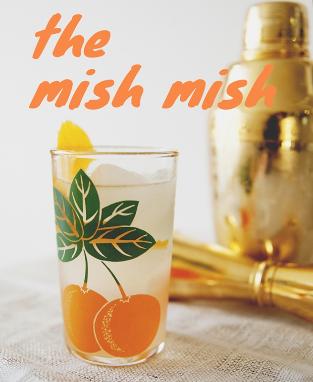 MISH MISH COCKTAIL in glass with an orange on it and brass cocktail shaker behind it // The Kitchy Kitchen