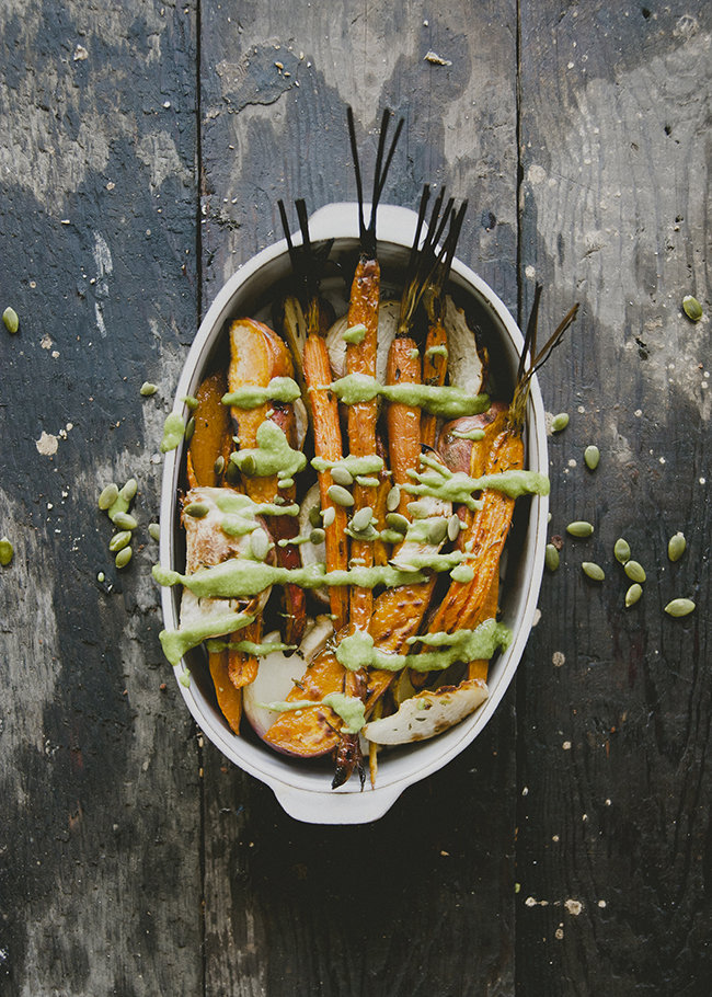 ROASTED VEGETABLES WITH PEPITA PESTO SERVED IN WHITE DISH ON RUSTIC WOOD TABLE // The Kitchy Kitchen