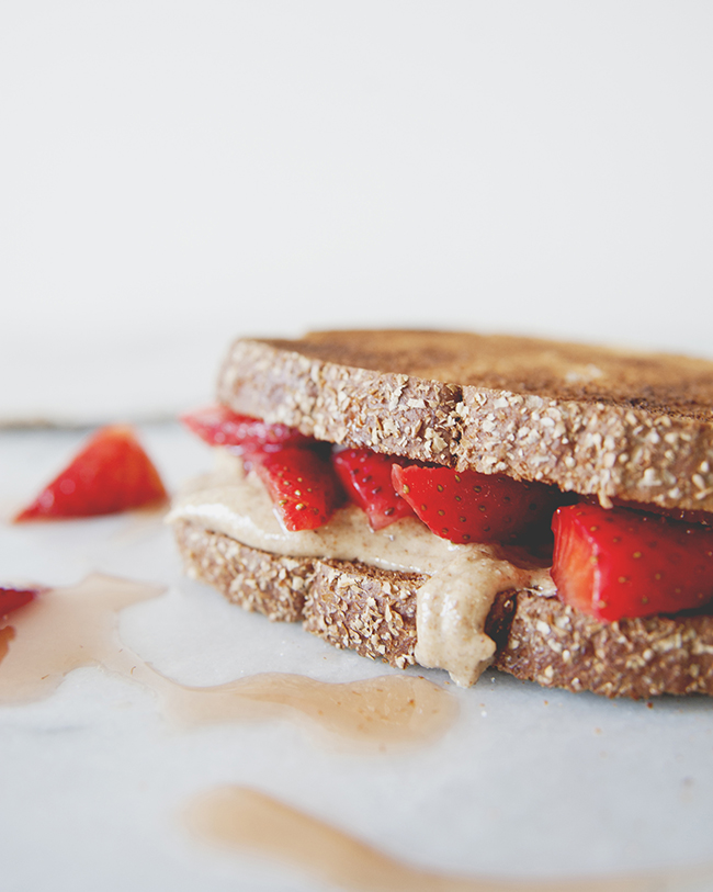 A twitst on the classic pb and j sandwich with macerated strawberries and homemade sea salt honey almond butter // The Kitchy Kitchen