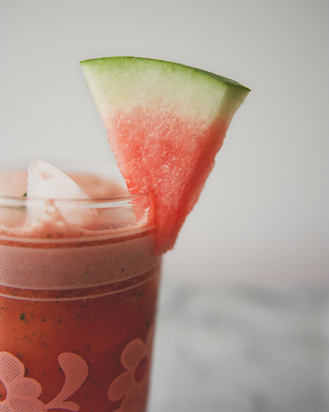 spicy watermelon mint agua fresca drink in a glass with a mini watermelon garnish // The Kitchy Kitchen