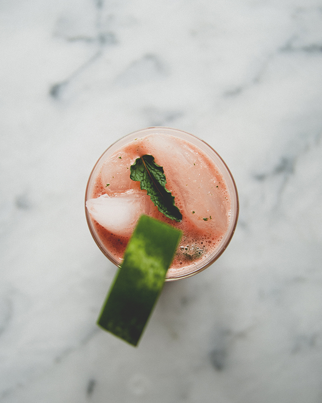 spicy watermelon agua fresca drink with mint and a mini watermelon garnish on a marble countertop // The Kitchy Kitchen