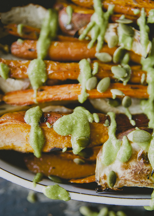 ROASTED VEGETABLES WITH PEPITA PESTO DRIZZLED OVER TOP WITH WHOLE PEPITAS // The Kitchy Kitchen