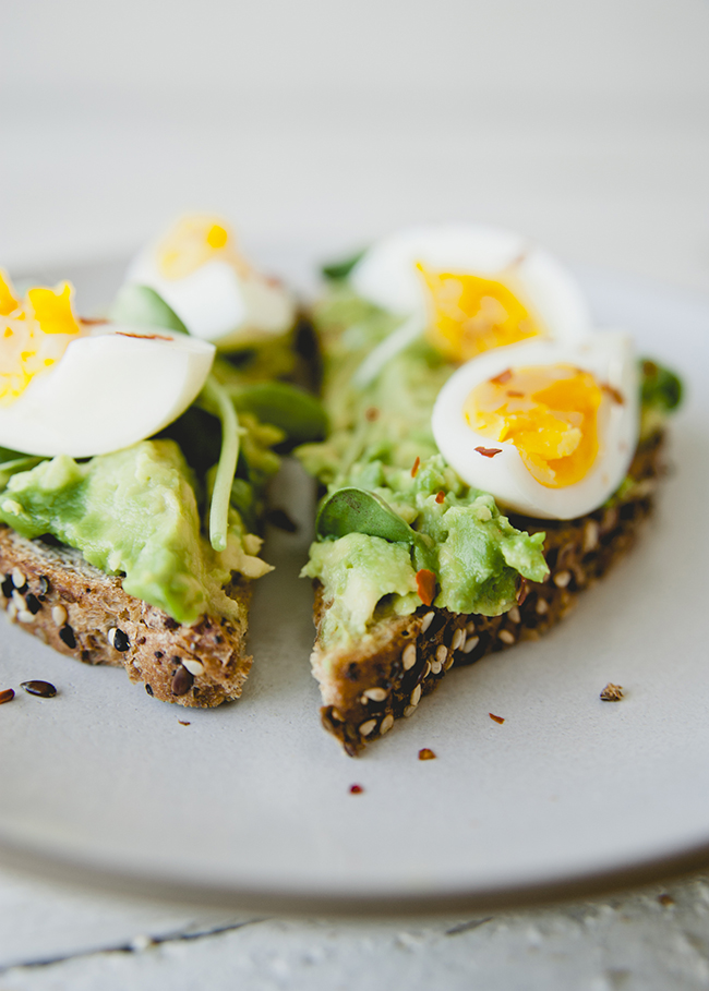 seeds the day eureka!® Organic Bread toasted with hard boiled eggs and smashed avocado on top  // The Kitchy Kitchen
